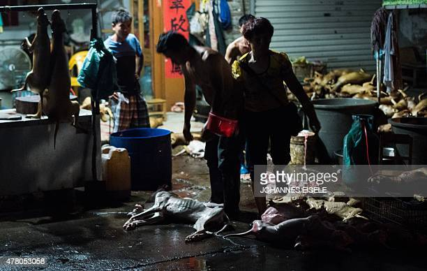 Cooked dogs are displayed at a vendor's stall in Yulin in southern China's Guangxi province early on June 22 2015 The city holds an annual festival...