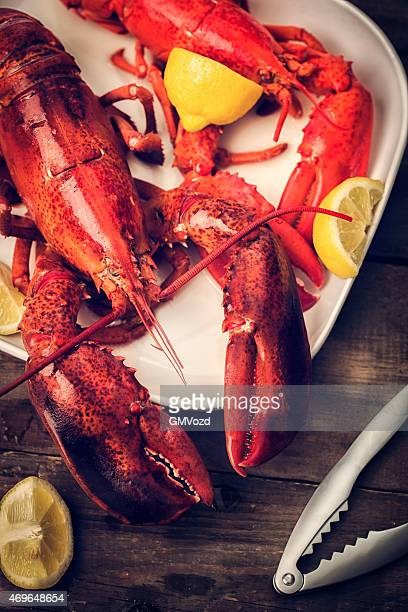 Cooked Lobster Garnished with Lemon and Parsley