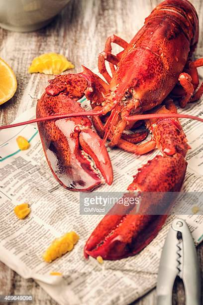 Cooked Lobster Served on Newspaper