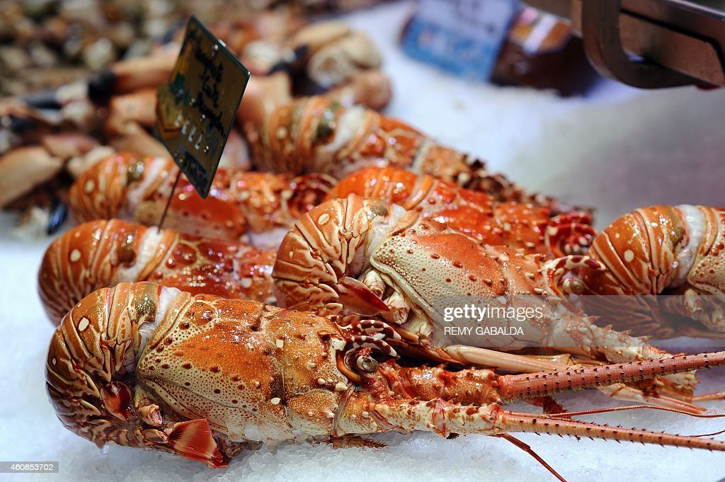 Cooked lobsters are seen for sale on a stall at the Victor Hugo market in downtown Toulouse on December 27 2014 AFP PHOTO / REMY GABALDA