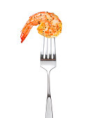 Cooked shrimp on fork isolated on white background