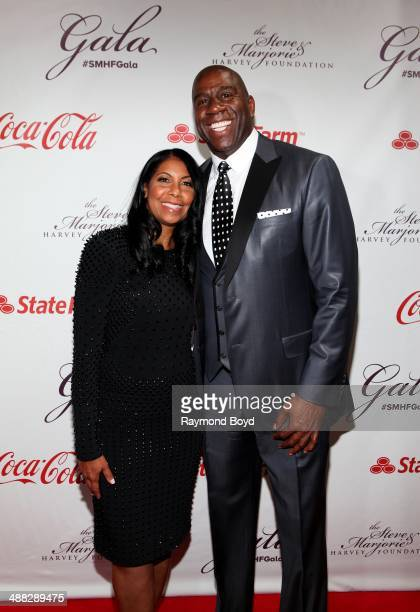 Cookie and Magic Johnson attends the 2014 Steve and Marjorie Harvey Foundation Gala presented by CocaCola at the Hilton Chicago on May 3 2014 in...