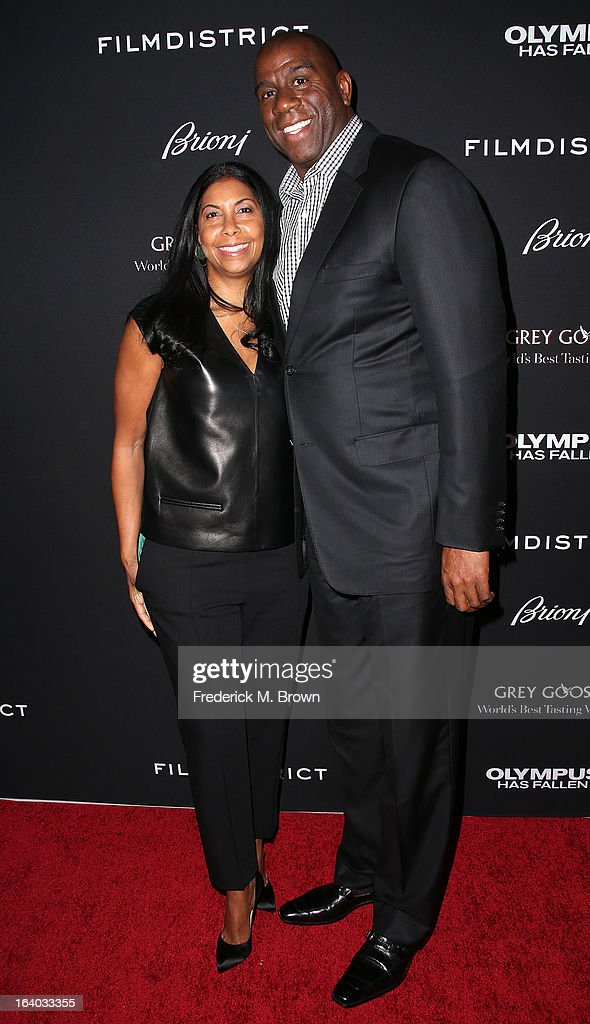 Cookie Johnson (L) and Earvin 'Magic' Johnson attend the Premiere of FilmDistrict's 'Olympus Has Fallen' at the ArcLight Cinemas Cinerama Dome on March 18, 2013 in Hollywood, California.