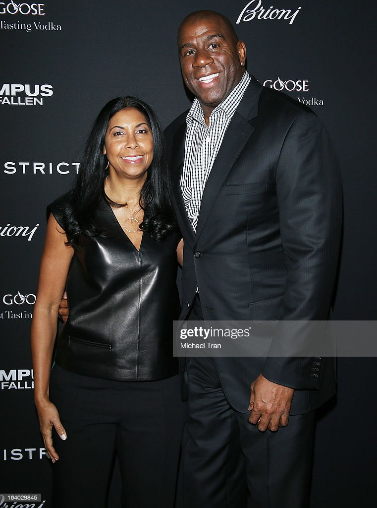 Cookie Johnson (L) and Magic Johnson arrive at the Los Angeles premiere of 'Olympus Has Fallen' held at ArcLight Cinemas Cinerama Dome on March 18, 2013 in Hollywood, California.