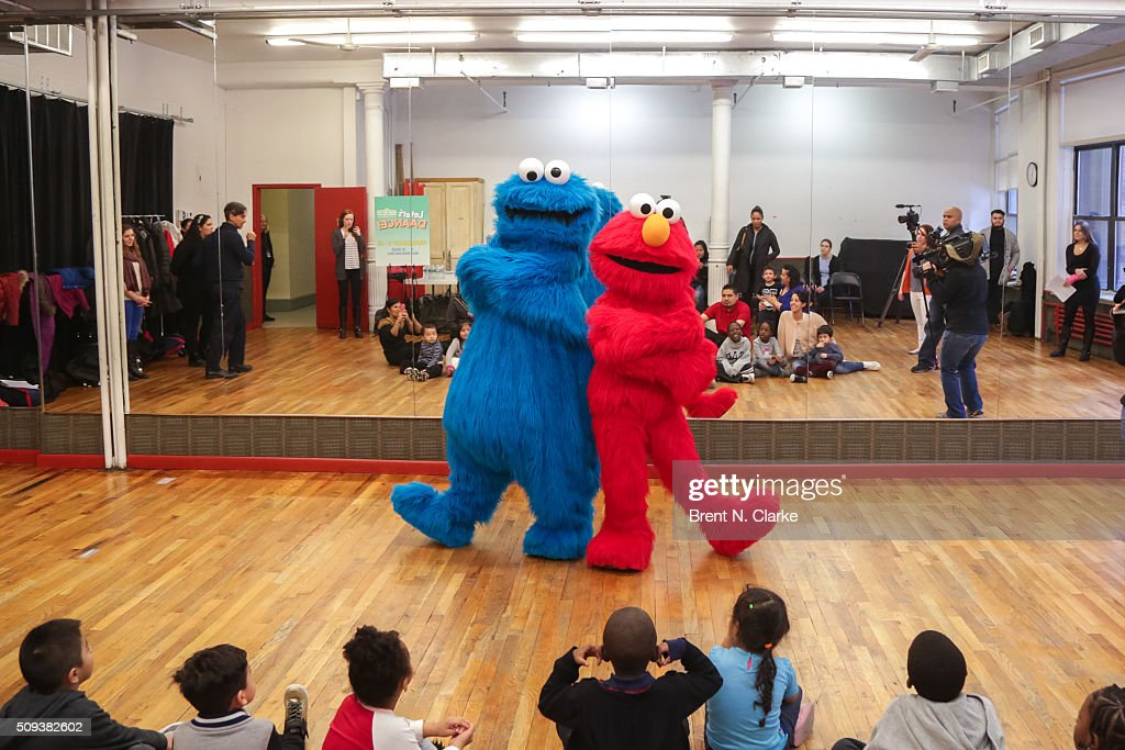 Cookie Monster and Elmo perform for the Children of the Garden of Dreams Foundation during the Sesame Street Live Dance Class held at Ripley Greer Studios on February 10, 2016 in New York City.