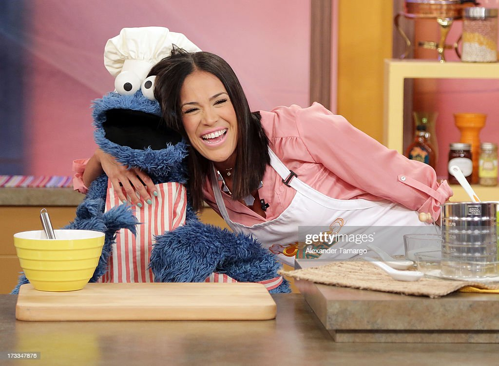 Cookie Monster and <a gi-track='captionPersonalityLinkClicked' href=/galleries/search?phrase=Karla+Martinez&family=editorial&specificpeople=732238 ng-click='$event.stopPropagation()'>Karla Martinez</a> are seen during Sesame Street's visit of Univision's 'Despierta America' at Univision Headquarters on July 12, 2013 in Miami, Florida.