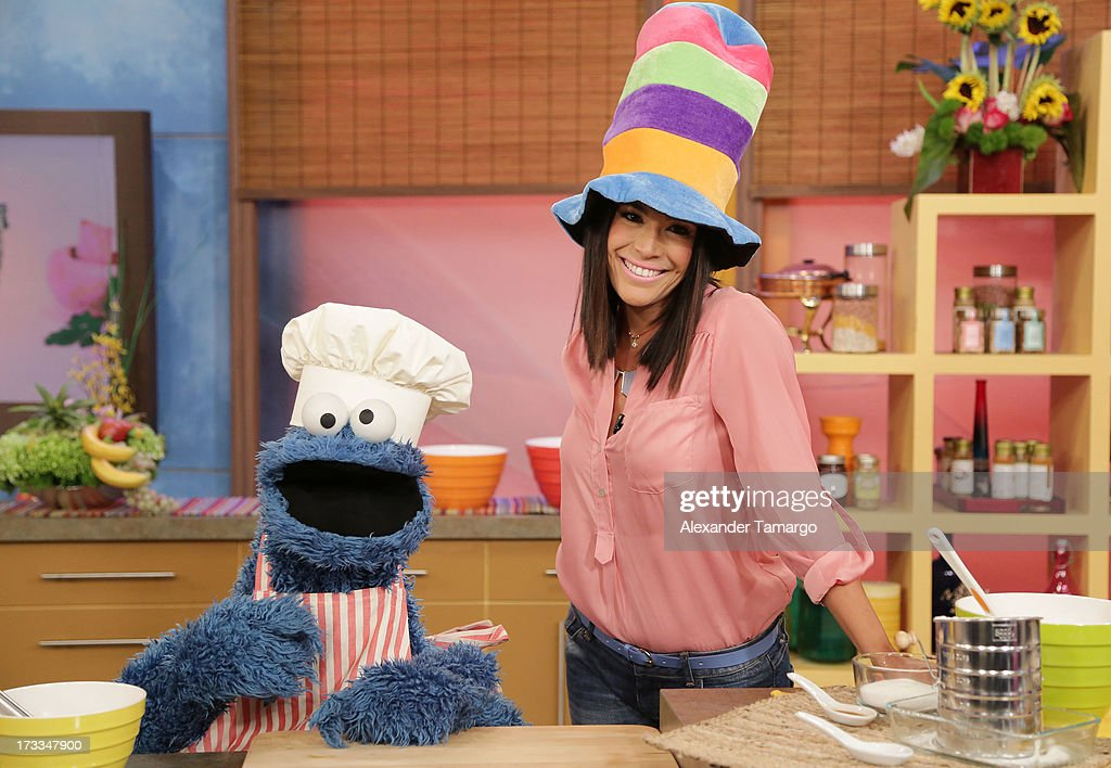Cookie Monster and Karla Martinez are seen during Sesame Street's visit of Univision's 'Despierta America' at Univision Headquarters on July 12, 2013 in Miami, Florida.