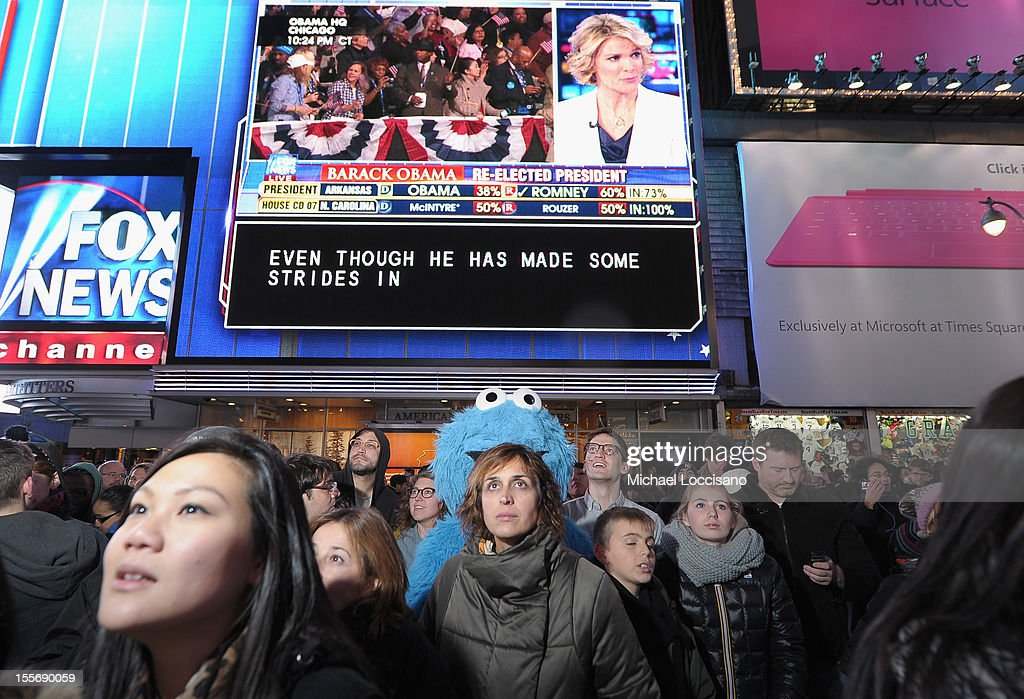 Cookie Monster and spectators come out in celebration of the 2012 Presidential Election night in Times Square on November 6, 2012 in New York City.