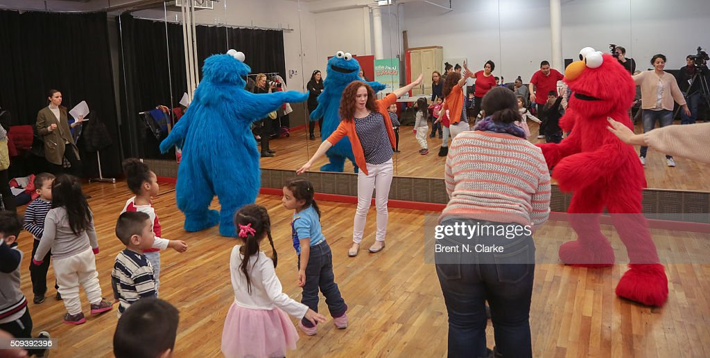 Cookie Monster, Elmo and Molly Jackson (C) perform with the Children of the Garden of Dreams Foundation during the Sesame Street Live Dance Class held at Ripley Greer Studios on February 10, 2016 in New York City.