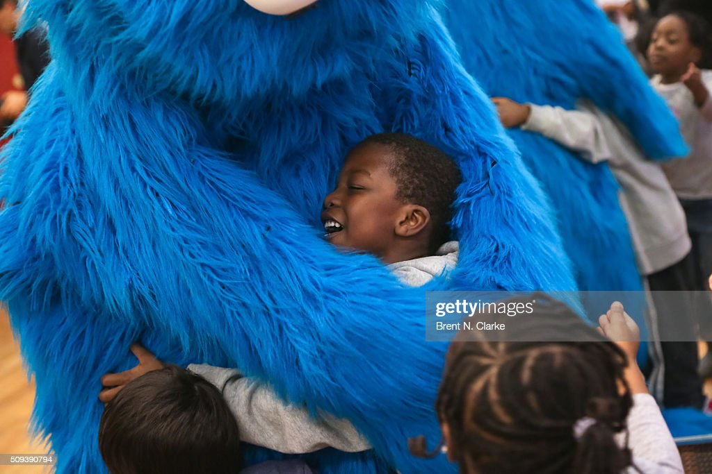 Cookie Monster gives a child from the Garden of Dreams Foundation a hug during the Sesame Street Live Dance Class held at Ripley Greer Studios on February 10, 2016 in New York City.