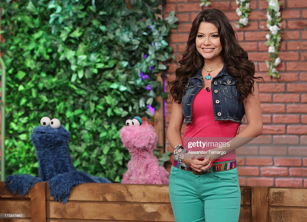 Cookie Monster, Lola and Ana Patricia Gonzalez are seen during Sesame Street's visit of Univision's 'Despierta America' at Univision Headquarters on July 12, 2013 in Miami, Florida.
