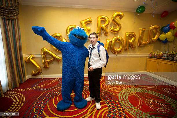 Cookie Monster poses with Jagger Lavely cofounder of The Foundation for Autism Acceptance Worldwide at the foundation's annual fundraiser on December...