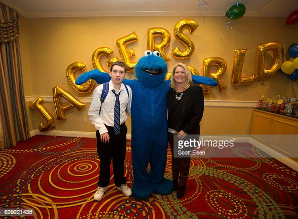 Cookie Monster poses with Jagger Lavely left cofounder of The Foundation for Autism Acceptance Worldwide and Connecticut Senator Heather Sommers at...