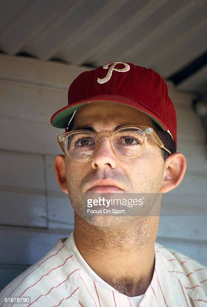 Cookie Rojas of the Philadelphia Phillies sits in the dugout at Connie Mack Stadium in Philadelphia Pennsylvania