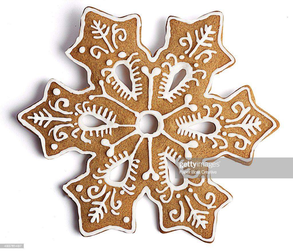 Cookie shaped as a snowflake with fancy decoration