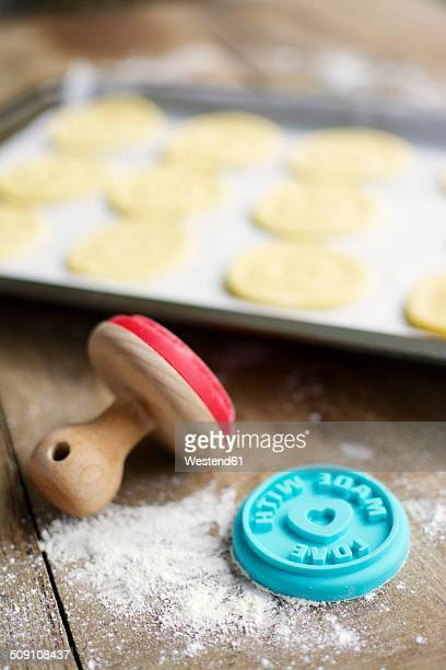 Cookie stamp and baking sheet with almond cookies