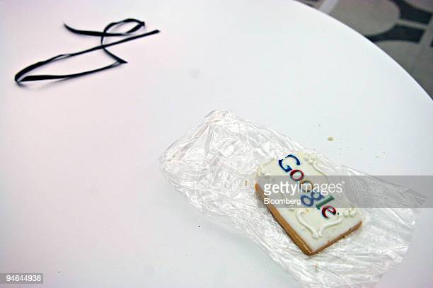 A cookie with the Google logo lays on a table in the game room of the Google office at 111 8th Avenue Monday October 2 2006 in New York