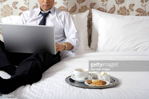 Cookies and coffee next to man in business attire