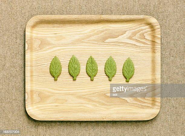 Cookies shaped leaf on the wooden tray,aerial view