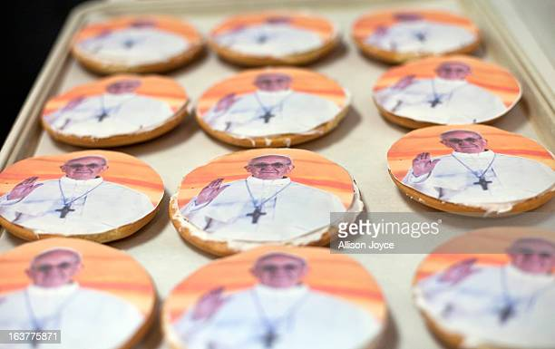 Cookies with the image of Pope Francis are sold at Artuso Pastry Shop March 14 2013 in the Bronx borough of New York City The conclave of cardinals...