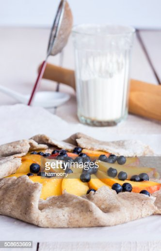 cooking biscuits with peach and blueberry : Stock Photo