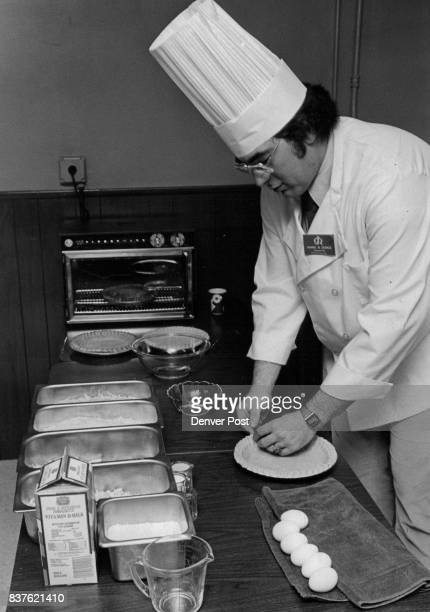 Cooking Cooks Daniel R Durick corporate executive with Gilbert Robinson Inc crimps edges of a pie shell as first step in demonstrating preparation of...