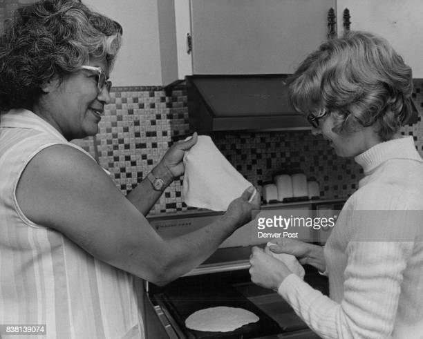 Cooking Cooks Tortillas Made For Burritos During Instruction Session Mrs Irene Gimeno left shows Mrs Robert Jones how to shape tortillas for making...