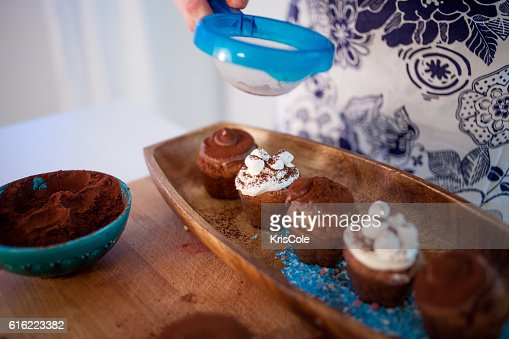 cooking cupcakes, muffins and a plate of ingredients for decoration : Bildbanksbilder