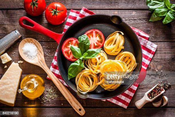 Cooking delicious italian tagliatelle