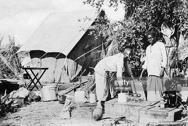 Cooking during an expedition in the jungle undated probably in the 1910's