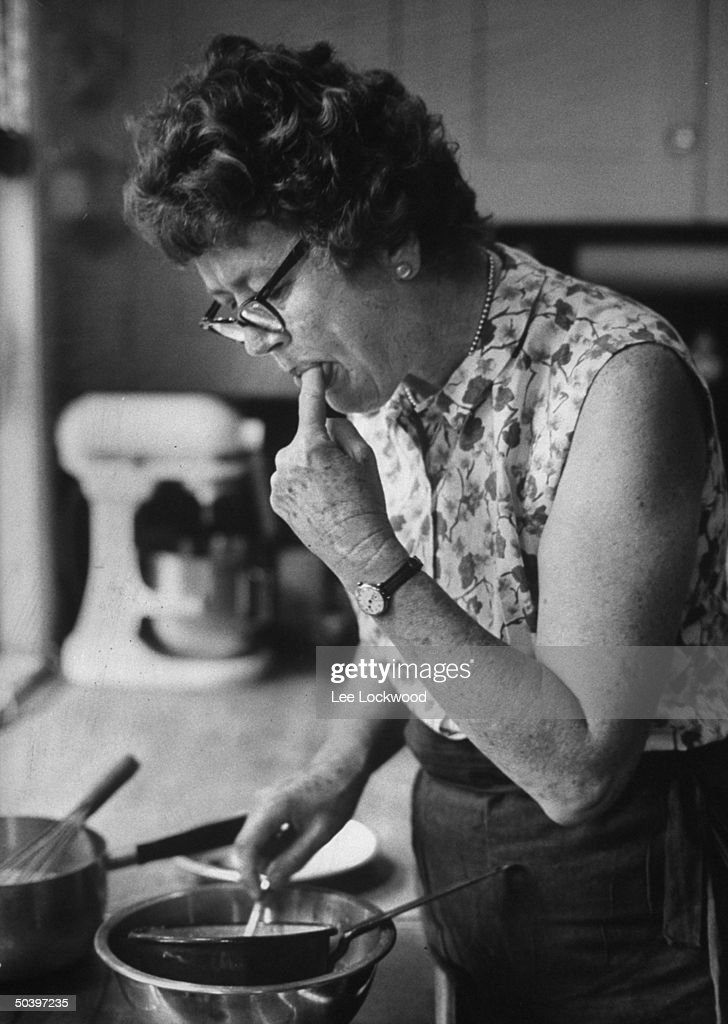TV cooking expert <a gi-track='captionPersonalityLinkClicked' href=/galleries/search?phrase=Julia+Child&family=editorial&specificpeople=206805 ng-click='$event.stopPropagation()'>Julia Child</a> tasting a concoction she is making at home.