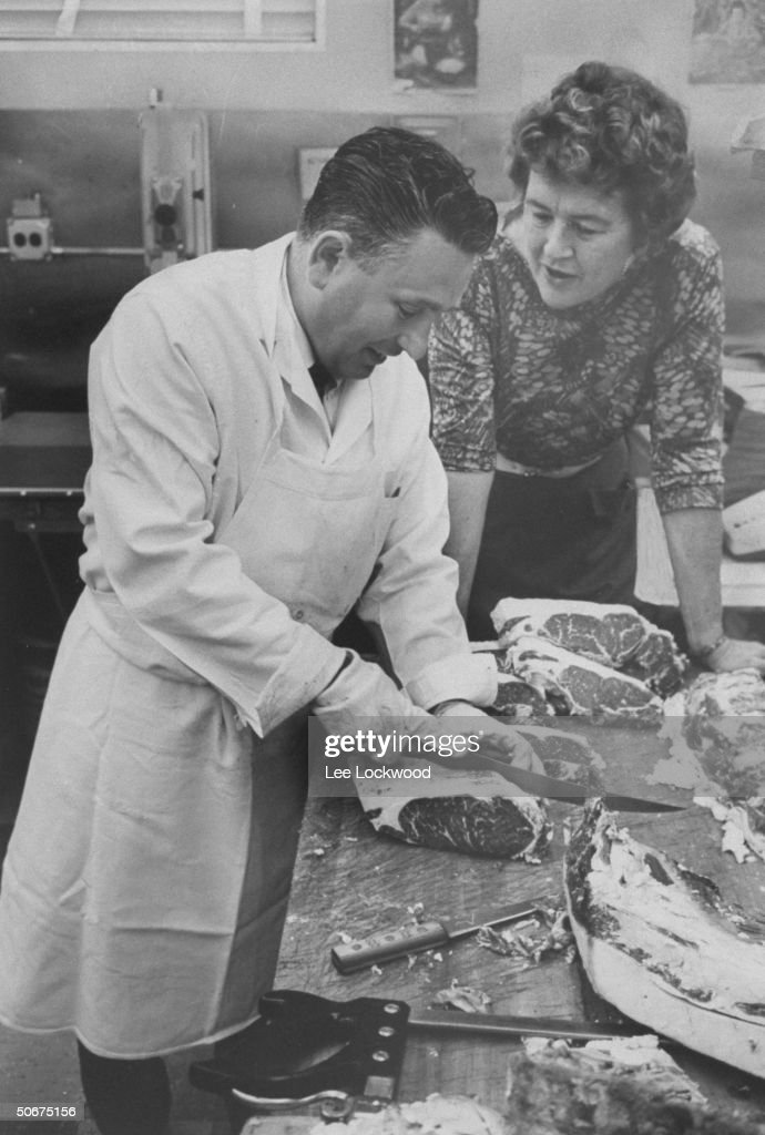 TV cooking expert <a gi-track='captionPersonalityLinkClicked' href=/galleries/search?phrase=Julia+Child&family=editorial&specificpeople=206805 ng-click='$event.stopPropagation()'>Julia Child</a> with her favorite butcher Jack Savendor.