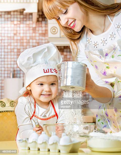 Cooking lesson for little daughter