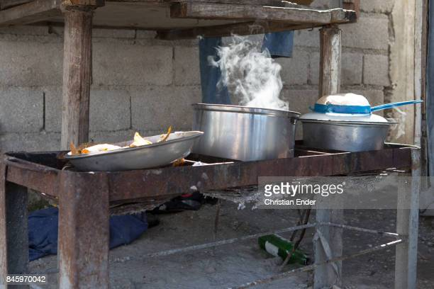 PortauPrince Haiti December 09 2012 A cooking place in the refugee camp Parc Colofe in PortauPrince The camp exist since the devastating earthquake...
