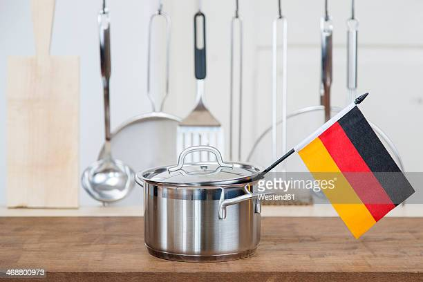 A cooking pot with a german flag in the kitchen