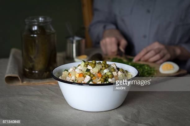 Cooking russian salad olivier