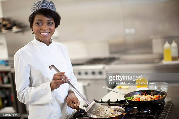 Cooking student at work in kitchen