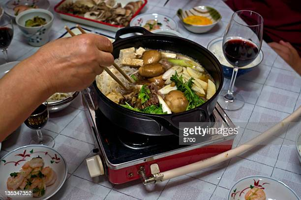 Cooking sukiyaki pot