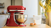 Cooking with red stand mixer on light kitchen
