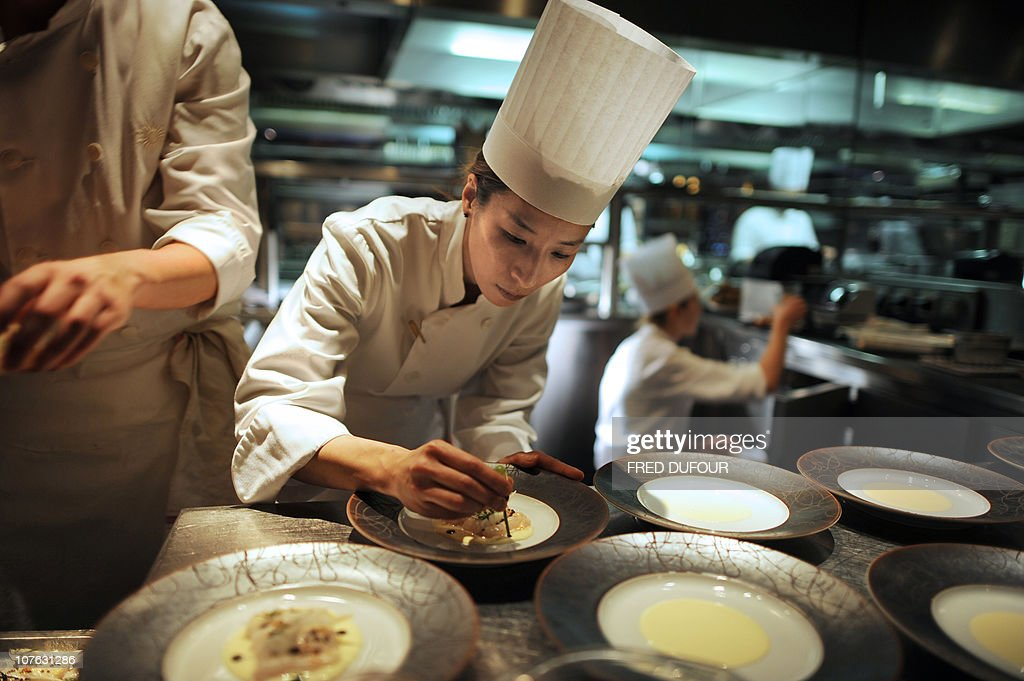 Cooks are at work on December 13, 2010 in the kitchen of the Hotel Hyatt Vendome in Paris.