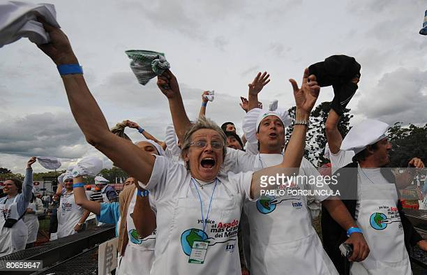 Cooks celebrate after obtaining the Guinness record to 'The World' s Biggest Barbecue' for grilling 12 000 kg of beef in Montevideo on April 13 2008...