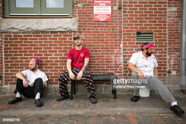 Cooks from Solo Italiano take one last smoke break in an alley behind the Thomas Block before a Friday dinner rush will keep them indoors and...
