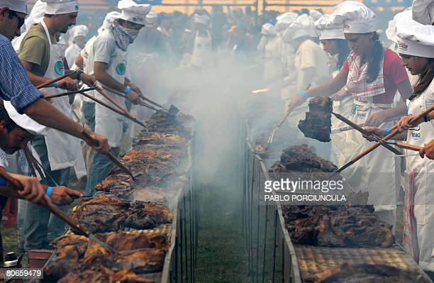 Cooks grill 12000 kg of beef during 'The World' s Biggest Barbecue' an event to break the Guinness record in Montevideo on April 13 2008 AFP PHOTO...
