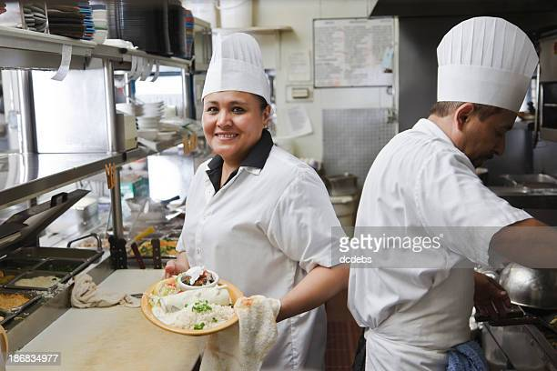 Cooks in a Mexican restaurant kitchen