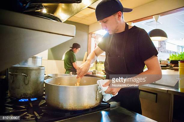Cooks in a small restaurant preparing for service