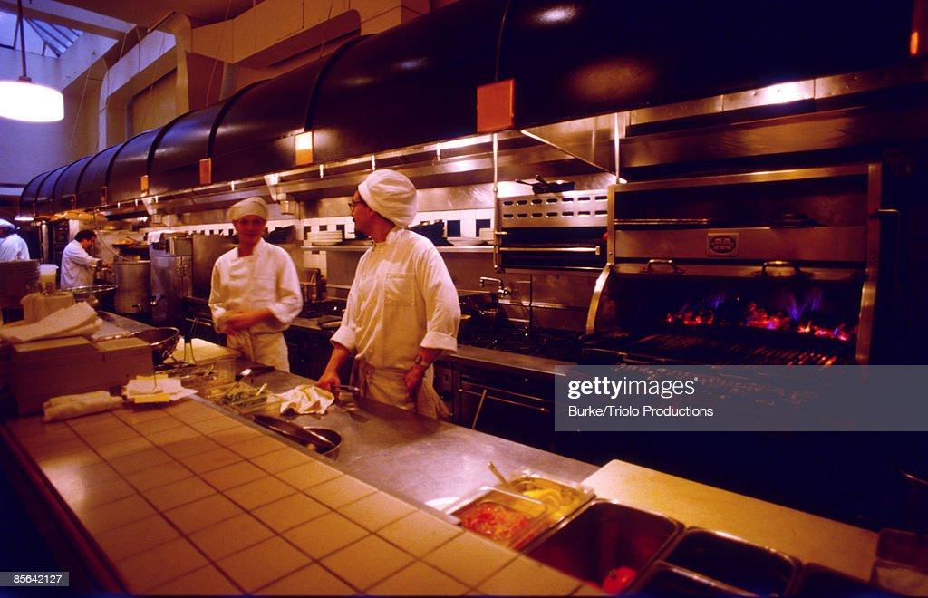 Cooks in restaurant kitchen : Stock Photo
