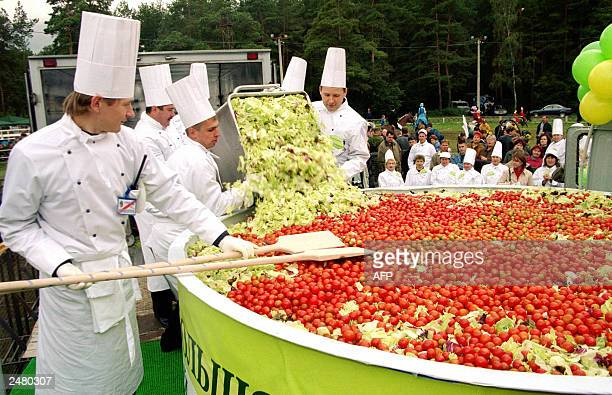 Cooks mix a giant salad in the village of Kotelniki outside Moscow 06 September 2003 When all the chopping and mixing is done the concoction of...