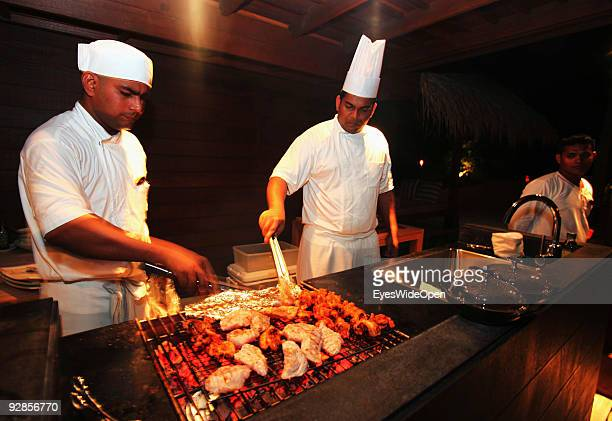 Cooks prepare a seafood dinner on the beautiful Villingili island owned by the luxurious ShangriLa's Villingili Resort and Spa Hotel on September 27...