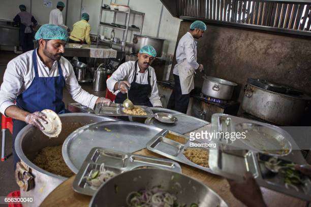 Cooks prepare and serve food at a canteen for Pakistani workers during a break at the Sindh Engro Coal Mining Co site in the Thar desert Pakistan on...