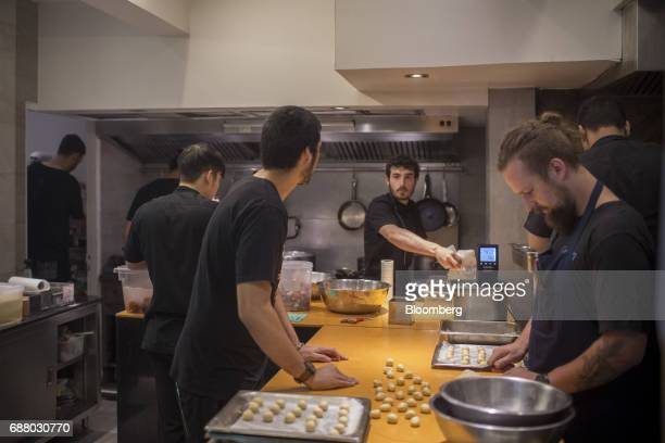Cooks prepare food in the kitchen of Gaggan restaurant in Bangkok Thailand on Thursday May 4 2017 After his restaurant's third straight win in Asia's...